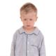 Little boy wearing pajamas and looking sad